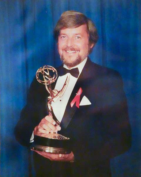 Lionel Friedberg shown holding Emmy Award 1993